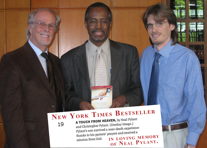 Neal Pylant, Christopher Pylant and Dr Ben Carson with the New York Times Bestselling E-book A Touch from Heaven